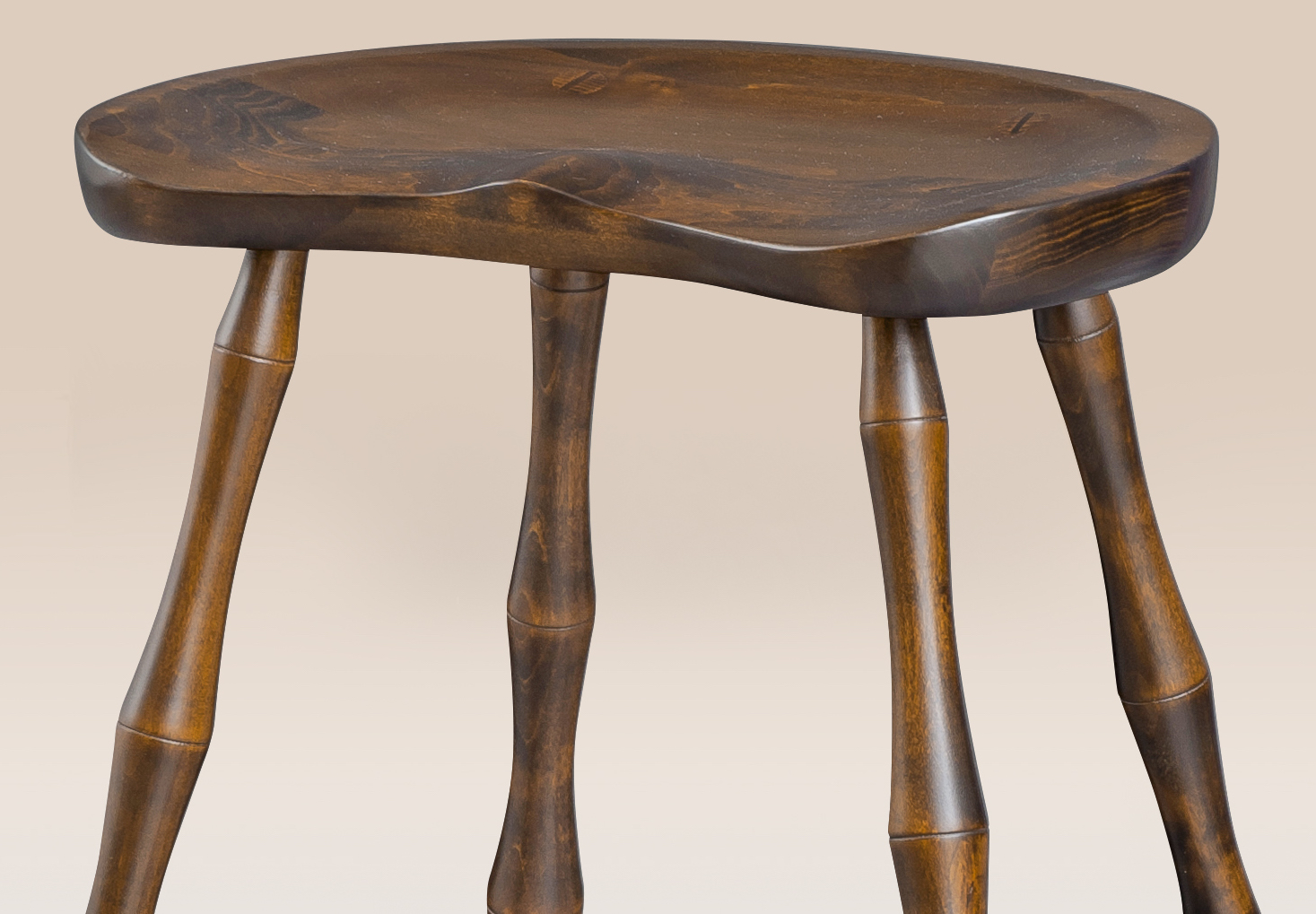 Historical saddle seat stool with bamboo style turnings